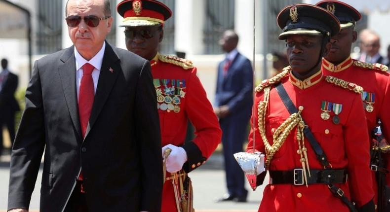 Turkey's President Recep Tayyip Erdogan (L) inspects an honor guard of Tanzania People's Defense Force soldiers during a welcoming ceremony at State House Grounds in Dar es Salaam on January 23, 2017
