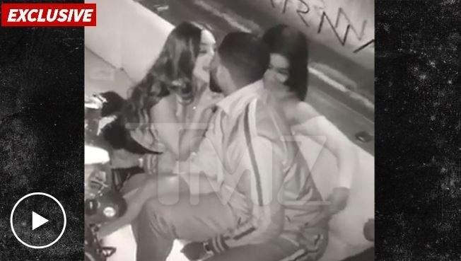 Tristan Thompson at lounge with 2 women making out