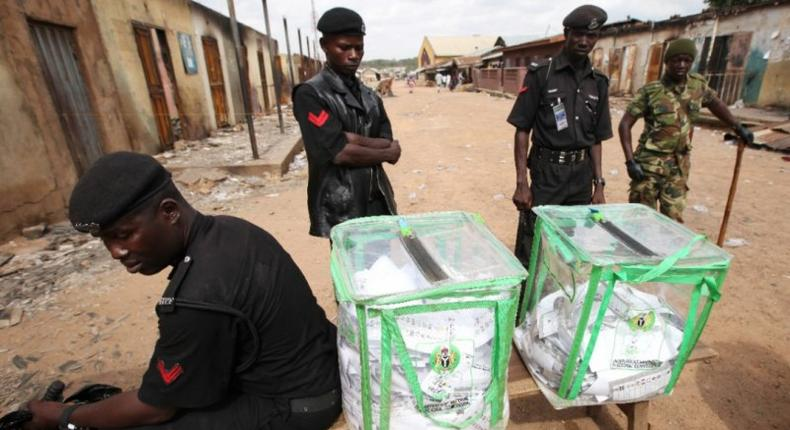 Security operatives safeguarding election box in Nigeria
