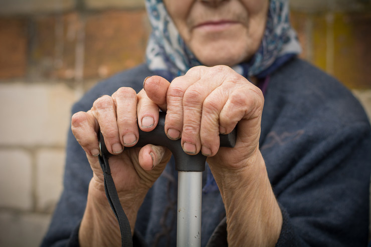 stock-photo-close-up-of-old-dirty-wrinkled-woman-hands-holding-walking-stick-senior-people-health-care-1074821669
