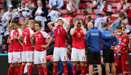 Denmark players were left visibly distraught by Christian Eriksen's on-pitch collapse Creator: Friedemann Vogel