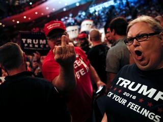 Supporters of Republican U.S. presidential nominee Donald Trump scream and gesture at members of the