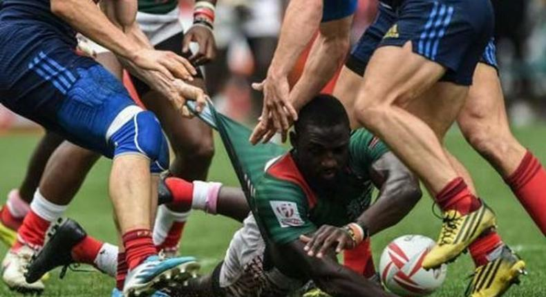 Shujaa player being handled by opponents during a past game