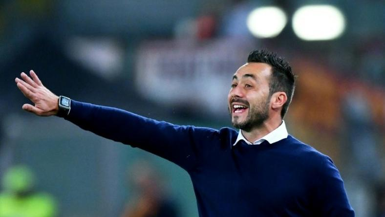 Palermo's Italian coach Roberto De Zerbi gestures during the Serie A match between AS Roma and Palermo at the Olympic stadium in Rome on October 23, 2016