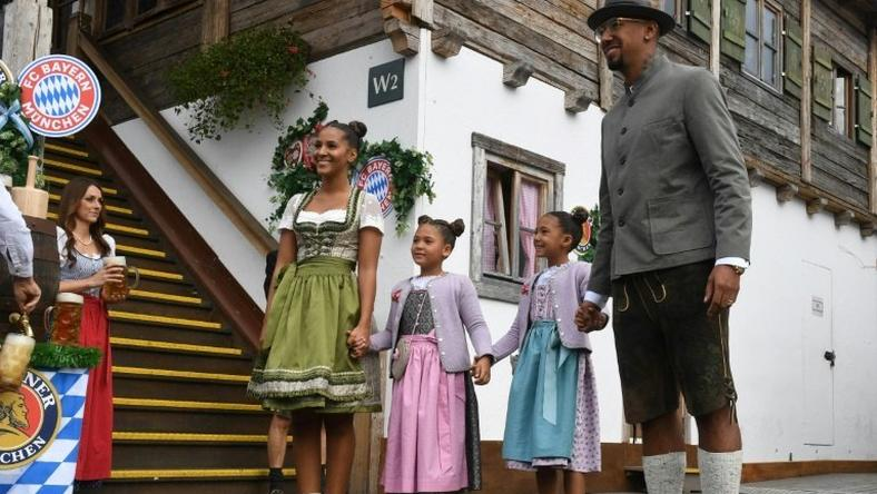 Bayern Munich defender Jerome Boateng with his family on a visit to the Munich beer festival