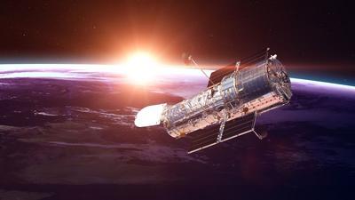 Kosmiczny Teleskop Hubble'a uchwycił odległą galaktykę i światło grawitacyjne