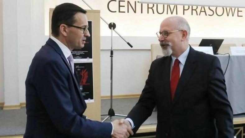 Premier Mateusz Morawiecki i wiceprezes PFN Maciej Świrski