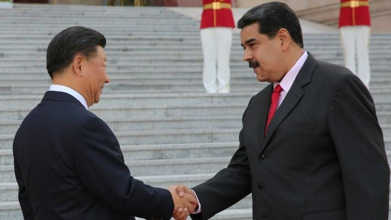 Venezuelan President Nicolas Maduro, shown here with Chinese counterpart Xi Jinping, says China agreed to oil industry financing