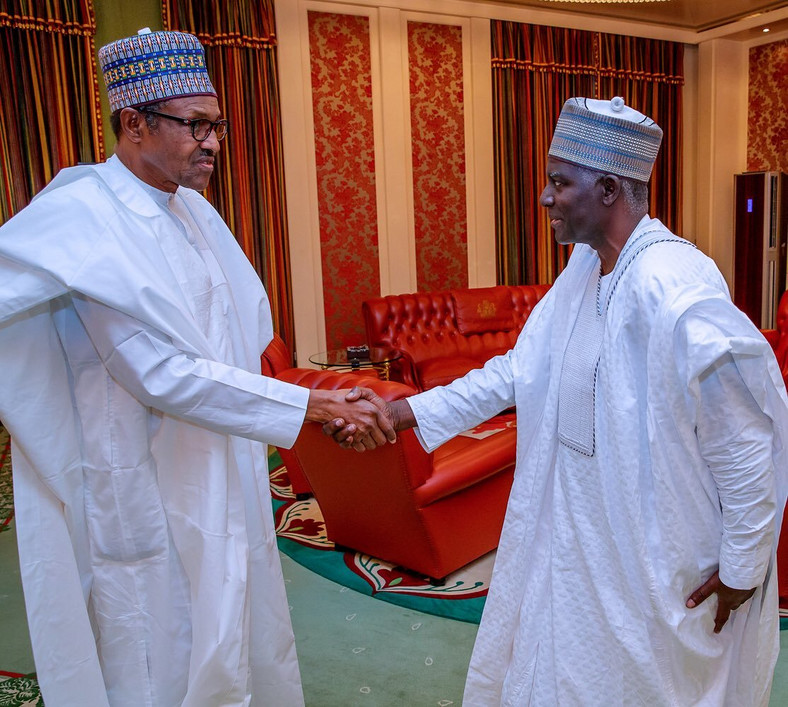 President Muhammadu Buhari shakes hands with the Director-General of the Department of State Services (DSS), Yusuf Magaji Bichi
