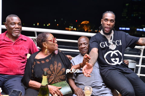 Burna Boy with his dad (far left) and grand parents at an event in 2018.