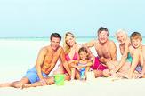 stock-photo-multi-generation-family-having-fun-on-beach-holiday-134771798