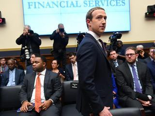 Facebook Chairman and CEO Zuckerberg arrives to testify at a House Financial Services Committee hearing in Washington