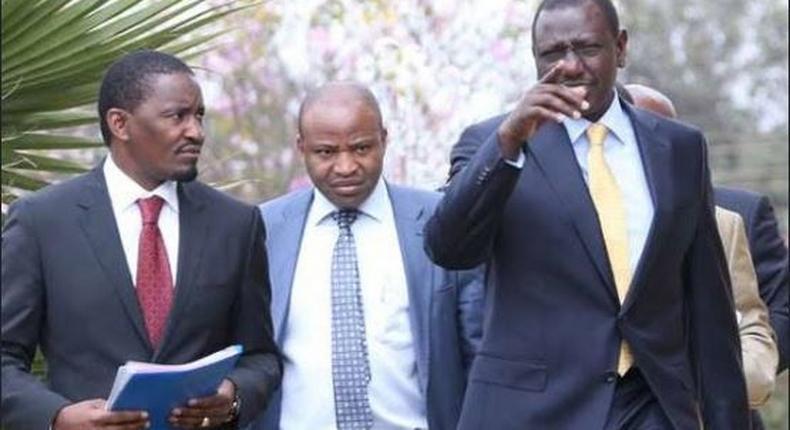 File image of Mwangi Kiunjuri (in a red tie) with DP Ruto