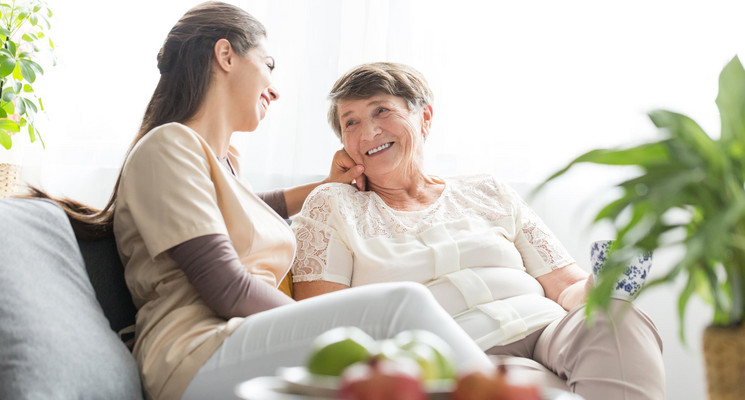 Woman talking with elderly mother