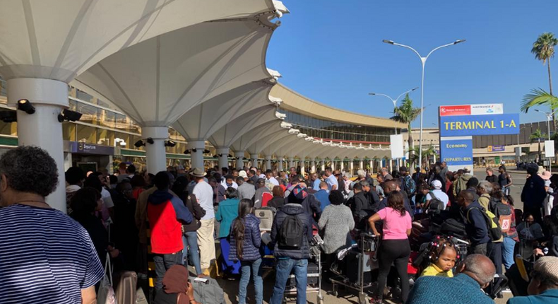 Kenya's Jomo Kenyatta International Airport grinds to halt after workers down tools, leaving a trail of injuries, arrests, tear gas and frustration