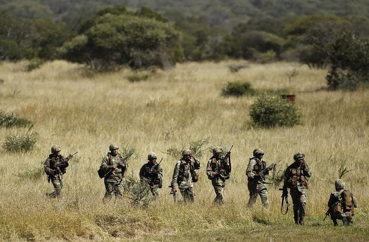 Members of the South African National Defence Force (SANDF) return after taking part in a Capability Demonstration at the Roodewal Bombing Range in Makhado, in the northern province of Limpopo, May 9, 2013. REUTERS/Siphiwe Sibeko