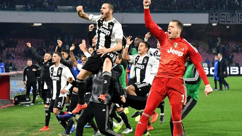 Juventus all-but-sealed their eighth straight Serie A title after winning 2-1 at Napoli to go 16 points clear at the top