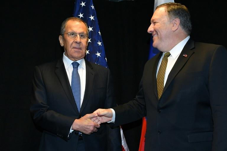 US Secretary of State Mike Pompeo shakes hands with Russia's Foreign Minister Sergei Lavrov as they meet on the sidelines of the Arctic Council meeting in Finland