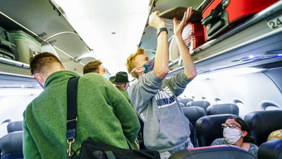Filling middle seats on airplanes doubles the risk of catching COVID-19, according to an MIT study