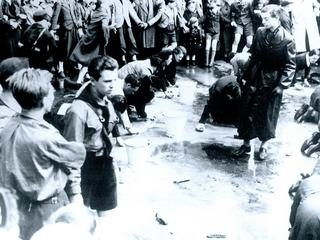 Austrian Jews forced to wash a street in Vienna following the German Anschluss (Annexation) of Austr
