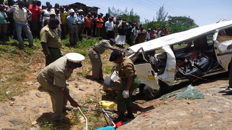 Police and the public at the scene of a recent accident