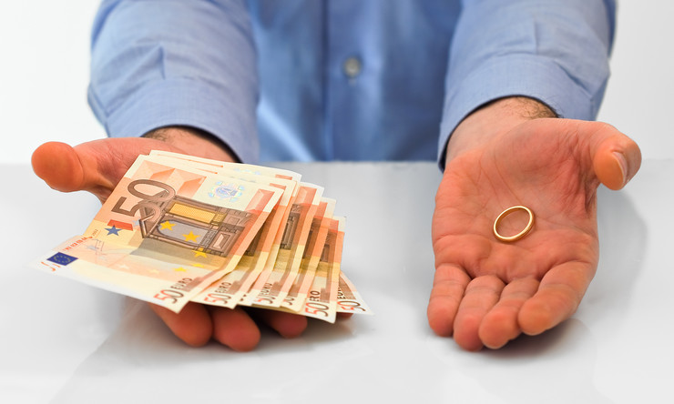 stock-photo-man-with-wedding-ring-and-money-92008844