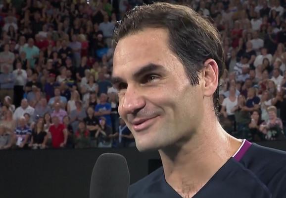Federer tokom razgovora sa Mekinroom posle pobede nad Krajinovićem u Melburnu