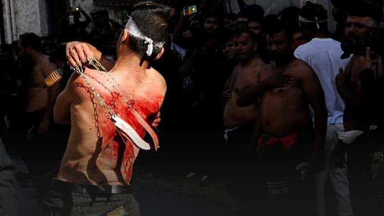 A Shi'ite Muslim living in Greece flagellates himself during a Muharram procession to mark Ashura in Piraeus, near Athens