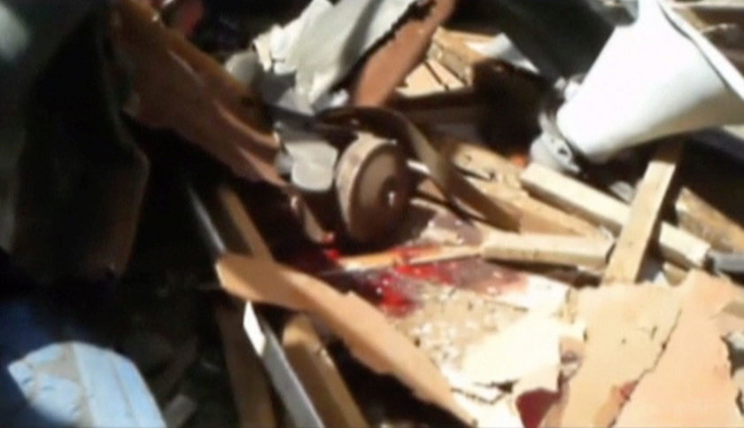 Still image taken from a video shows a blood stain at blast attack site in Mubi