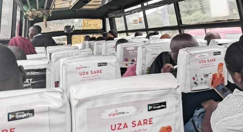 Passenger takes photo inside a Route 111 (Ngong, Karen) matatu that complied with maximum of 60 per cent capacity to facilitate social distancing