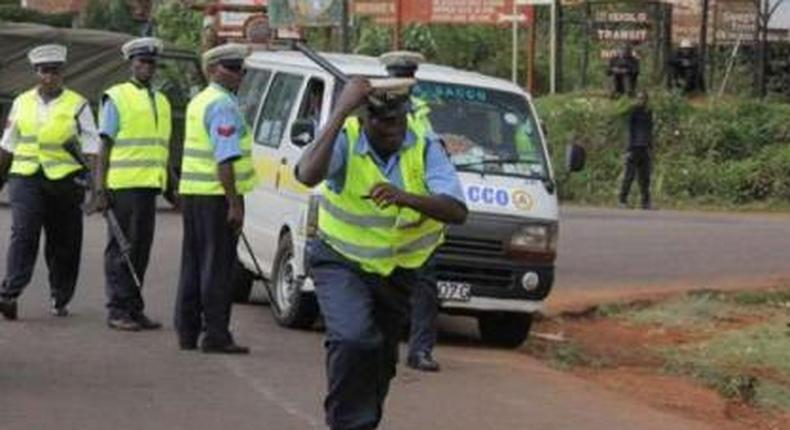 File image of police on duty. NTSA has taken action after outrage over viral video of Meru Shuttle crew jecting woman and child from matatu