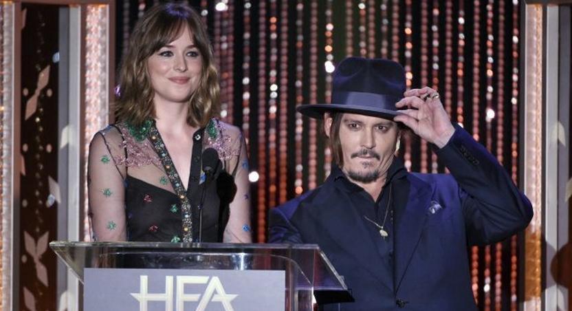 Dakota Johnson and Johnny Depp at the Hollywood Film Awards