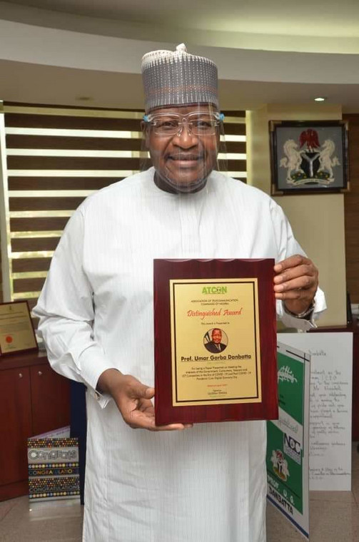 Executive Vice Chairman/CEO, Nigerian Communications Commission (NCC), Prof. Umar Garba Danbatta displaying the award.