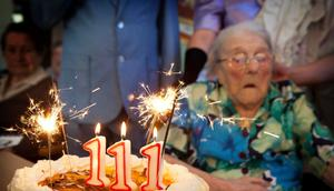 Odette Ambulher celebrates her 111th birthday in a retirement home in the French village of Laigne-en-Belin in October 2012.