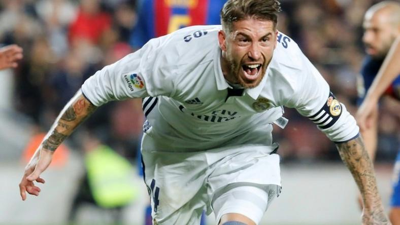 Real Madrid's defender Sergio Ramos celebrates after scoring a goal during the Spanish league football match FC Barcelona vs Real Madrid CF at the Camp Nou stadium in Barcelona on December 3, 2016