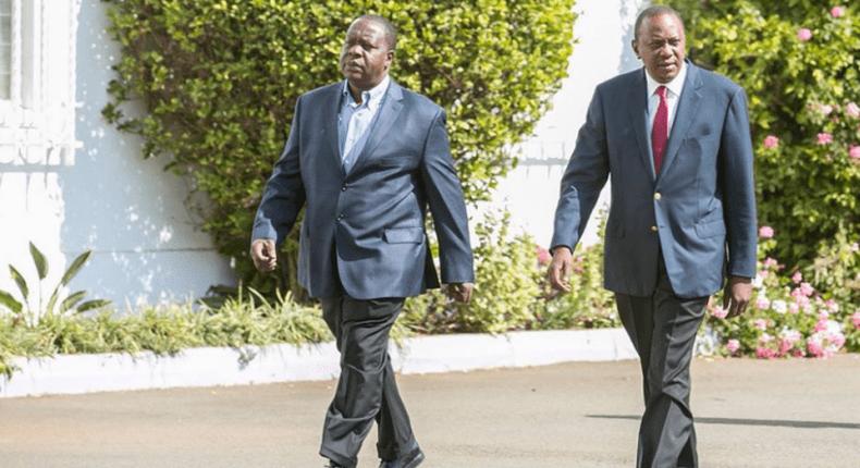 President Uhuru Kenyatta with CS Fred Matiang'i