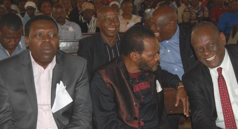 President Kenyatta's cousin Ngengi Muigai (C) speaks with former Jubilee Vice Chair David Murathe (Twitter)