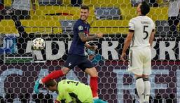 France's defender Lucas Hernandez (L) celebrates after an own goal by Germany defender Mats Hummels (R) Creator: Matthias Schrader
