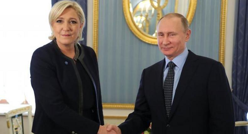 Russian president, Vladmir Putin shakes hands with French presidential candidate, Marine Le Pen.