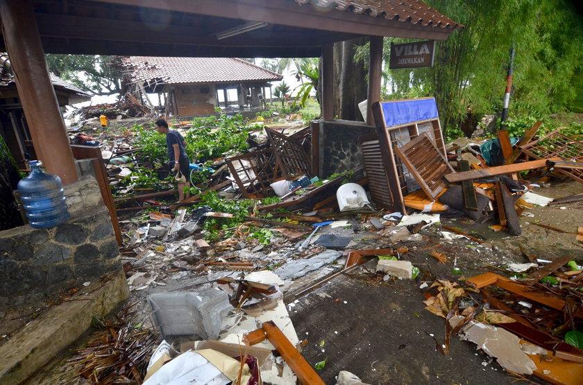 A man stands among ruins after a tsunami hit at Carita beach in Pandeglang, Banten province