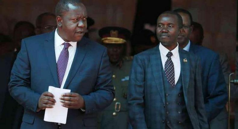 Interior CS Fred Matiang'i and ICT CS Joe Mucheru. Government takes action after M-Pesa outage