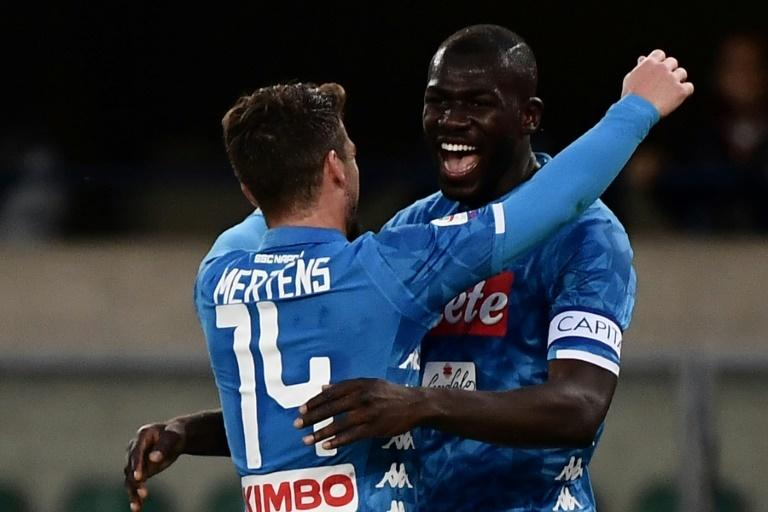 Koulibaly (R) celebrates with Dries Mertens after scoring his second goal