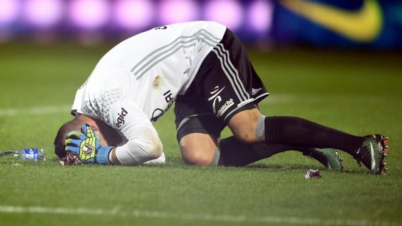 Lyon goalkeeper Anthony Lopes reacts after a firecracker exploded beside him during an away match against Metz on December 3, 2016