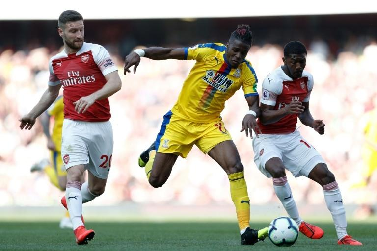 Under pressure: Even after Ainsley Maitland-Niles came on, Shkodran Mustafi and the Arsenal defence struggled to cope with Wilfried Zaha