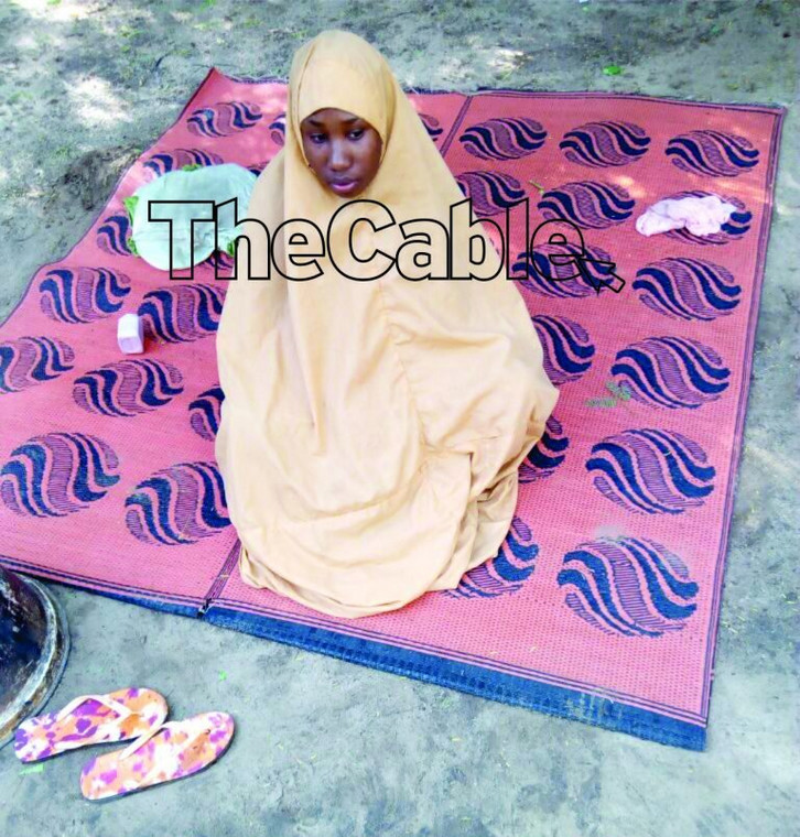 Leah Sharibu, pictured here in Boko Haram custody when Saifura Ahmed was executed, has been in captivity for 14 months [TheCable]