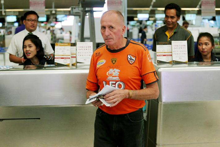 British caver Vern Unsworth is seen at a check-in counter at Bangkok's International Airport