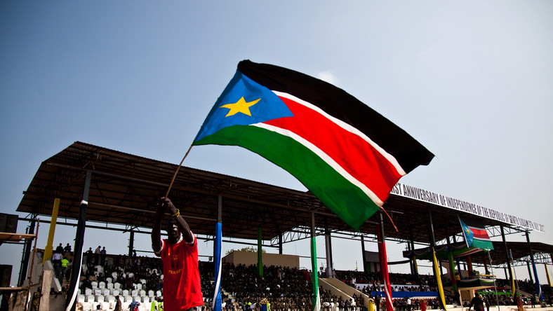 A man waves the national flag of South Sudan during celebrations to mark the country's first anniversary of its independence in Juba, July 9, 2012.