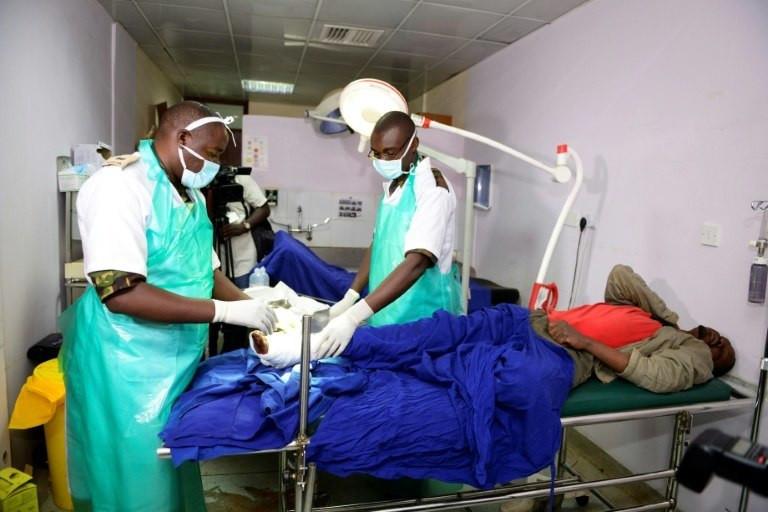 Kenyan Defence force doctors attend to an injured man at Kenyatta National Hospital in Nairobi in December 2016