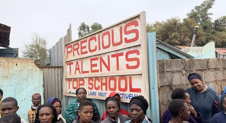 Onlookers on-site at Precious Talents School where 4 pupils were feared dead on Monday morning after building collapsed