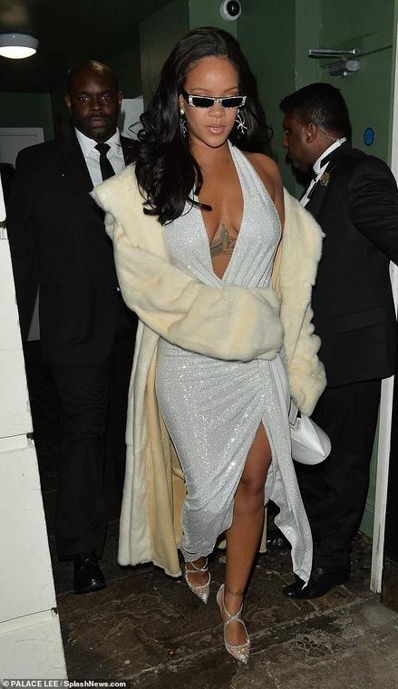 Rihanna looks amazing in a plunging dress as she celebrates New Years in London